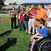 Dignitaries from Enid Noon AMBUCS, 4RKids Board of Directors and Miracle League baseball players applaud as Brandon Morris (back left), Union Pacific Railroad Director of Public Affairs, makes a $15,000 donation to 4RKids Miracle League at AMBUCS ABC Park Wednesday, July 9, 2014. The donation will be used for Phase III of the park renovation. (Staff Photo by BONNIE VCULEK)