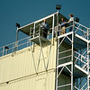 Bert Mackie (top center) peers down as he tours the new fire training tower at Autry Technology Center Tuesday, July 29, 2014. The facility on the southwest side of the campus will assist Autry Tech students and area firefighters with confined space rescue, high-angle rescue, aerial and ground ladder rescue, search and rescue, mayday and rapid intervention, search dog training, EMT scenario training and SWAT team exercises. (Staff Photo by BONNIE VCULEK)