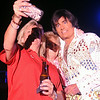 An Elvis fan takes a selfie with Mary Feightner and International Elvis Entertainer Marshall Matthews at Enid Event Center and Convention Hall Saturday, July 12, 2014. (Staff Photo by BONNIE VCULEK)