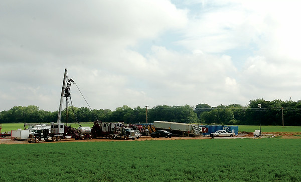 A fracking-related spill dumped 480 barrels of hydrochloric acid southwest of Hennessey west of the Turkey Creek Bridge on EW660 Monday, July 28, 2014. Clean up continues as the Oklahoma Department of Environmental Quality inspects the site Thursday, July 31, 2014. According to Matt Skinner, the spokesman for the Oklahoma Corporation Commission, the HCL acid spill is probably the largest of its kind in the state. (Staff Photo by BONNIE VCULEK)