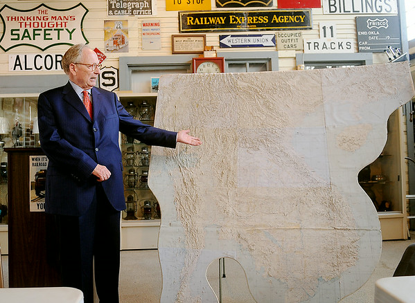 Stephen Jones, an Enid attorney, discusses a 6' x 6' three-dimensional map of Vietnam during a presentation at the Railroad Museum of Oklahoma Wednesday, July 9, 2014. During a tenure in Washington D.C., Jones and Sen. Paul Finley initiated the recognition of United States service men and women who perished from injuries sustained during the Vietnam War. The names of the fallen are listed on the Vietnam Memorial Wall in Washington D.C. and the permanent memorial at Woodring Wall of Honor and Veterans Park at Enid Woodring Regional Airport. (Staff Photo by BONNIE VCULEK)