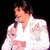 """International Elvis Entertainer Marshall Matthews performs """"The American Trilogy"""" as he honors American Veterans at Enid Event Center and Convention Hall Saturday, July 12, 2014. (Staff Photo by BONNIE VCULEK)"""