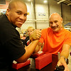 Allen Fisher (right), the twenty-six time world Bishido arm wrestling champion warms up for competition with another puller at the Chisholm Trail Coliseum Saturday, July 12, 2014. More than 150 entered the event hosted by Anew Church in Enid. (Staff Photo by BONNIE VCULEK)