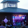 LED lights illuminate the Kiwanis Carousel at Meadowlake Park as guests arrive for the annual Fourth of July fireworks show Friday, July 4, 2014. (Staff Photo by BONNIE VCULEK)