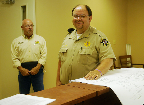 Garfield County Sheriff Jerry Niles pauses near the renovation blueprints of the Garfield County Public Safety Building on the Garfield County Fairgrounds. Renovation of the facility should be complete in September. (Staff Photo by BONNIE VCULEK)