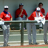 A baseball sails toward home plate while the Dallas Mustangs use wet towels to keep cool in their dug out in the 104 degree temperatures during the Connie Mack Regional Baseball Tournament at David Allen Memorial Ballpark Saturday, July 26, 2014. (Staff Photo by BONNIE VCULEK)