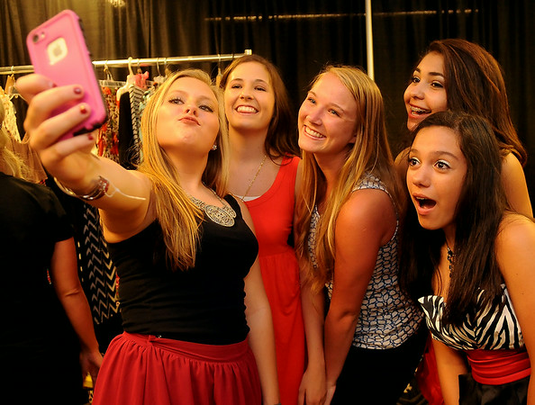 Etown Fashion Week models pause for a selfie before they walk the red carpet at Convention Hall Friday, July 11, 2014. (Staff Photo by BONNIE VCULEK)