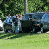 Enid Police Officers investigate a 4-vehicle accident on Cleveland Friday, July 11, 2014. (Staff Photo by BONNIE VCULEK)