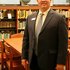 Dr. Darrell Floyd, the new superintendent for Enid Public Schools, pauses inside the Enid High School library Thursday, July 17, 2014. (Staff Photo by BONNIE VCULEK)