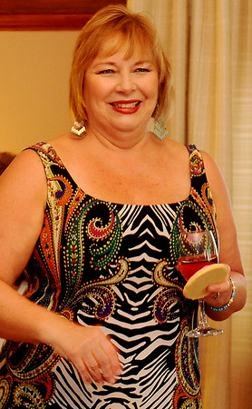 Cathy Nulph, the director for Etown Fashion Week, greets guests at Maple Place Bed & Breakfast during media night Monday, July 7, 2014. Proceeds from the week-long events support Loaves & Fishes, the Northwest Oklahoma Regional Food Bank in Enid. (Staff Photo by BONNIE VCULEK)