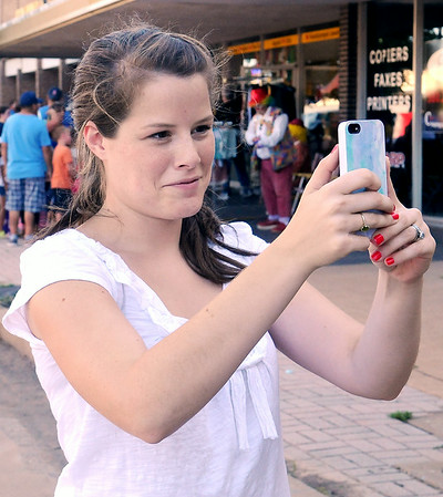 Mary Katherine Henley, a summer intern from Main Street Enid, creates a 6-second video during Second First Friday in downtown Enid July 11, 2014. (Staff Photo by BONNIE VCULEK)