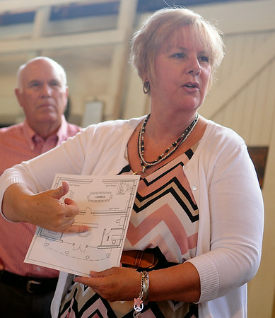 Elaine Johns explains the plans for the new Woodring Wall of Honor and Veterans Park Education Center during donation presentations at the Railroad Museum of Oklahoma in Enid Wednesday, July 9, 2014. (Staff Photo by BONNIE VCULEK)
