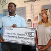 Connie Blankenship (right) listens, as Brandon Morris, Union Pacific Director of Public Affairs for Oklahoma and Arkansas, announces a $7,500 donation to the Wall of Honor and Veterans Park Education Center at the Railroad Museum of Oklahoma in Enid Wednesday, July 9, 2014. (Staff Photo by BONNIE VCULEK)