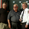 Fire Safety Instructor Josh Stephens, Autry Technology Center Superintendent Dr. James Strate and Enid Fire Department Chief Joe Jackson pause for a portrait next to Engine 1 following the ribbon cutting ceremony for the new fire training tower at Autry Technology Center Tuesday, July 29, 2014. (Staff Photo by BONNIE VCULEK)