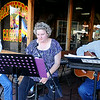 """""""Back Home Again"""" performs outside Soapweeds & Cactus during Main Street Enid's Second First Friday in downtown Enid July 11, 2014. (Staff Photo by BONNIE VCULEK)"""