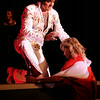 """International Elvis Entertainer Marshall Matthews places a scarf around a fan's neck as he sings """"Love Me Tender"""" at Enid Event Center and Convention Hall Saturday, July 12, 2014. (Staff Photo by BONNIE VCULEK)"""