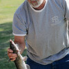 Dennis Hoopingarner holds an 18.5 inch catfish while fishing derby officials measure the rest of his morning's catch at Meadowlake Park Friday, July 4, 2014. (Staff Photo by BONNIE VCULEK)