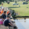 The Nichols family fishes from the Kiwanis Train Bridge at Meadowlake Park during the Fourth of July Fishing Derby Friday, July 4, 2014. (Staff Photo by BONNIE VCULEK)