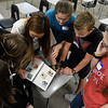 Waller Middle Schoolers, Kaytlyn Parks, Tricity Wilson-Betchen, Sarah Kim, Kadee Jo Ransom, Statton Martz and Lorryn Fuller, look for clues to figure out the combitation of a lock a Kalahari class Thursay July 27, 2017. (Billy Hefton / Enid News & Eagle)