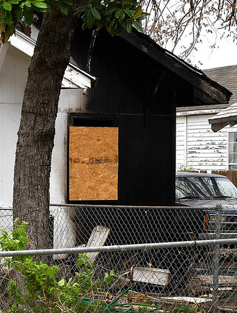 A boarded window at the residence at 823 W Oak that was damaged by fire. (Billy Hefton / Enid News & Eagle)