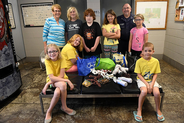 Kids from the Teen Summer Reading Program at the Enid Public Library deliveried items they made to the Enid Animal Shelter Friday July 28, 2017. (Billy Hefton / Enid News & Eagle)