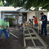 Members of the AM AMBUCS, Michael Manley, Dan Blubaugh and Paul Kelly and members of the Enid Fire Department, Jason Cunningham and Matt Toews, work to build a ramp for WWII vet and retired firefighter, Phil Shafford, Saturday July 22, 2017. (Billy Hefton / Enid News & Eagle)
