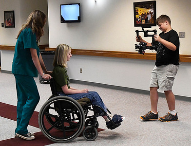 Baylor Gehay records Sydney Rogers and Hannah Tomlinson during a class for the Fly Flim Festival at NWOSU Enid Thursday July 20, 2017. (Billy Hefton / Enid News & Eagle)