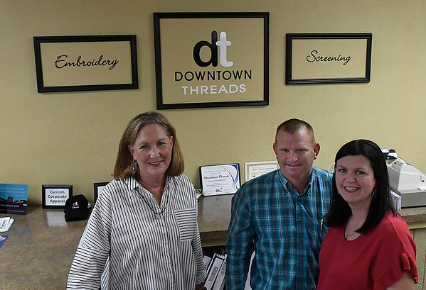 Downtown Threads former owner, Vicki Brown (left) and new owners, Brandi Schieber and Russell Schieber Wednesday July 18, 2018. (Billy Hefton / Enid News & Eagle)
