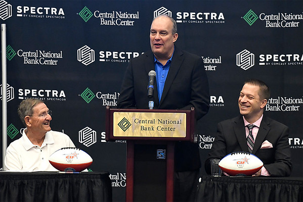 Richard Davis, GM/coach of the new Enid team, is flanked by Enid Mayor, Bill Shewey (left) and Champions Indoor Football League commissioner, Rick Bertz during a press conference announcing the new Enid franchise Tuesday July 24, 2018 at the Central National Bank Center. (Billy Hefton / Enid News & Eagle)