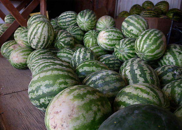 Home grown watermelons at the K & S Produce stand east of Ringwood Wednesday July 25, 2018. (Billy Hefton / Enid News & Eagle)
