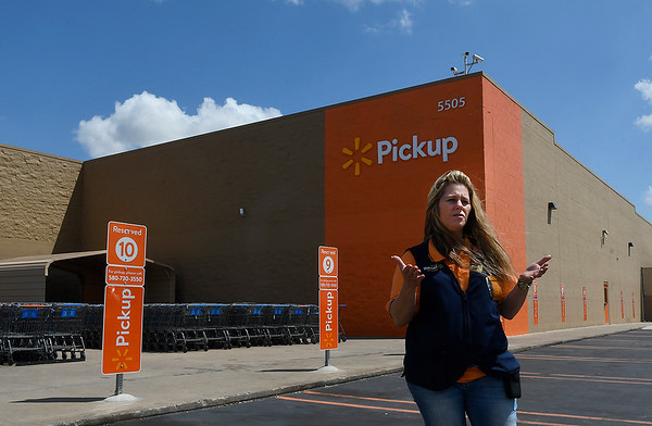Tracy Hartman gestures as she talks about the procedure for the new grocery pickup service at the Walmart Supercenter on west Garriott. The service begins August 7. (Billy Hefton / Enid News & Eagle)