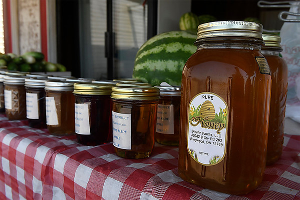 Local honey at the K & S Produce stand east of Ringwood Wednesday July 25, 2018. (Billy Hefton / Enid News & Eagle)