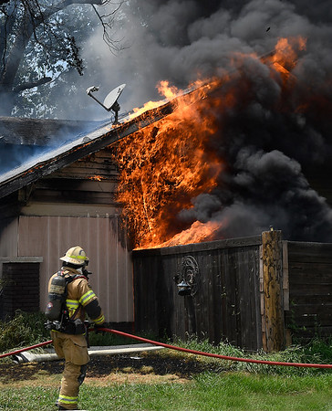 Enid firefighters work a house fire at 1334 E. Randolph Tuesday, July 16, 2019. (Billy Hefton / Enid News & Eagle)