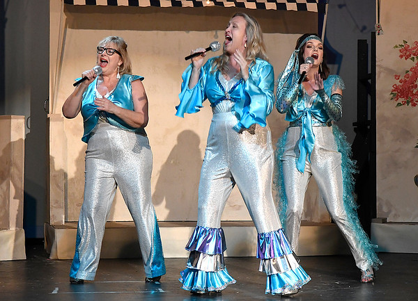 "(left to right) Cathy Nulph, Jill Ruding and Angela Lyons rehearse a song from the Gaslight Theater production of ""Mamma Mia"" Wednesday, July 10, 2019. (Billy Hefton / Enid News & Eagle)"