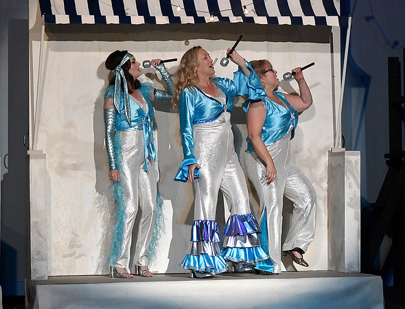 """(left to right) Angela Lyons, Jill Ruding and Cathy Nulph rehearse a song from the Gaslight Theater production of """"Mamma Mia"""" Wednesday, July 10, 2019. (Billy Hefton / Enid News & Eagle)"""