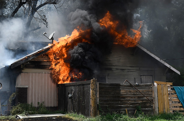 Flames engulf a house at 1334 E. Randolph Tuesday, July 16, 2019. (Billy Hefton / Enid News & Eagle)