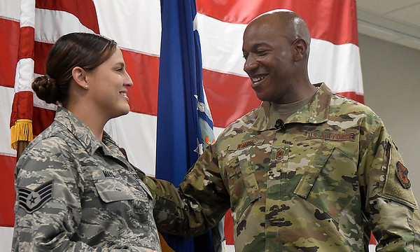 Chief Master Sergeant of the Air Force Kaleth O. Wright talks with Staff Sergeant Kayla Mays during a visit to Vance Air Force Base Monday, July 29, 2019. (Billy Hefton / Enid News & Eagle)