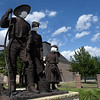 """Masks have been placed on the Harold Holden sculpture """"The Homesteaders"""" at the Cherokee Strip Regional Heritage Center Wednesday, July 8, 2020. (Billy Hefton / Enid News & Eagle)"""