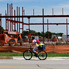 A cyclist rides on Cleveland Street pass the construction of the new Jiffy Trip in The District Tuesday, July 21, 2020. (Billy Hefton / Enid News & Eagle)