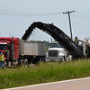 A milling machine removes asphalt from U.S. Highway 81 near Kremlin Thursday, July 16, 2020. (Billy Hefton / Enid News & Eagle)