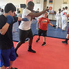 Tim Mosley leads a boxing class at Humanitarian School of Martial Arts Monday, July 19, 2021. (Billy Hefton / Enid News & Eagle)