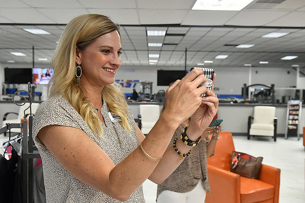 Laura Hatchel, Membership & Special Events Director for the Greater Enid Chamber of Commerce takes video during a ribbon cutting at Kristi's Kitchen Thursday, July 1, 2021. (Billy Hefton / Enid News & Eagle)