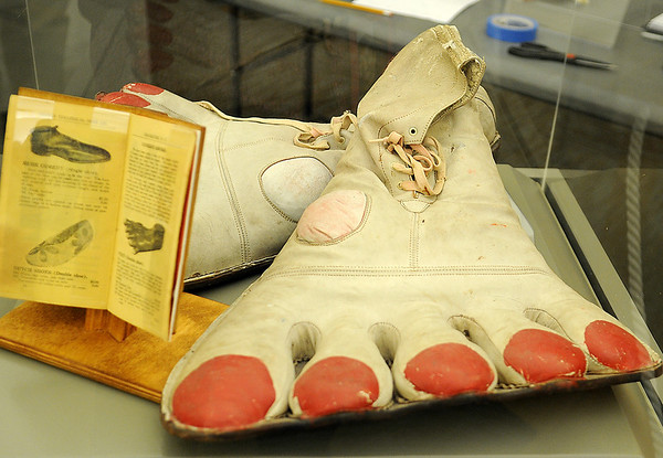 """Javier """"Peluza"""" Esparza's shoes from his performances with the Polark Bros. Circus in 1962. (Staff Photo by BONNIE VCULEK)"""