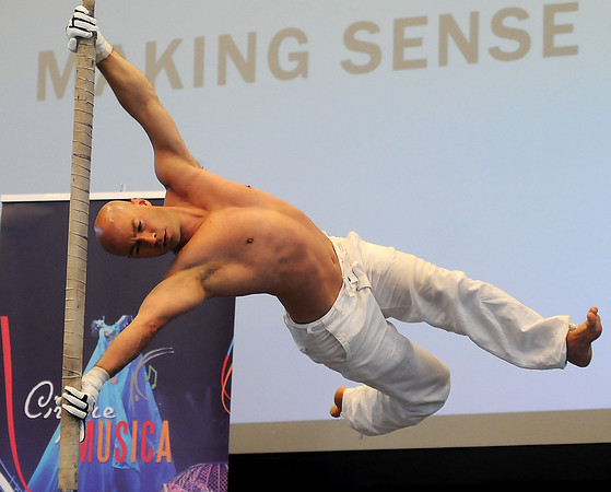 Darren Bersuk, a former member of the National Gymnastics Team, entertains the crowd during a Cirque Musica power tower performance at the grand opening of the Enid Event Center Wednesday, June 12, 2013. (Staff Photo by BONNIE VCULEK)
