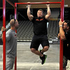 Iron Works' Mark Welch completes 35 pull ups during the Enid Event Center grand opening Wednesday, June 12, 2013. (Staff Photo by BONNIE VCULEK)