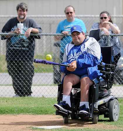 As Miracle League fans watch, Jeff Jung connects for a base-clearing hit for the Dodgers at AMBUCS' ABC Park Saturday, June 29, 2013. Following each of the two final games, players received medallions and certificates. (Staff Photo by BONNIE VCULEK)