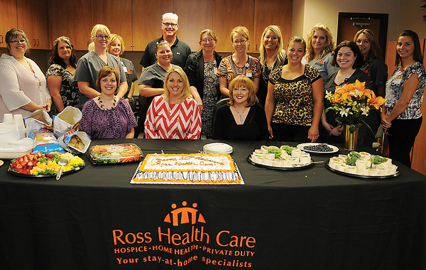 Ross Home Health Care employees pause for a portrait during the Enid company's 10th anniversary party at 427 E. Cherokee Wednesday, June 26, 2013. (Staff Photo by BONNIE VCULEK)