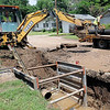 City of Enid Water Reclamation Services employees repair a 14 inch water main near the home of Jarry Hillman on Pierce Street, between Cherokee and Oklahoma Thursday, June 6, 2013. (Staff Photo by BONNIE VCULEK)