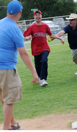Enid AMBUCS President Eli Berry points to home plate as the Angel's Travis eludes a tag and scores after his grand slam hit at the Miracle League games at ABC Park Saturday, June 8, 2013. (Staff Photo by BONNIE VCULEK)