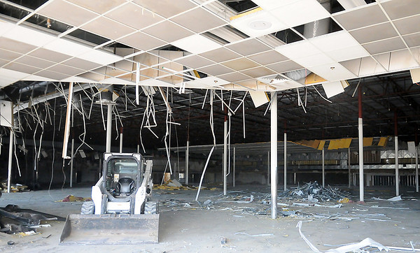 The interior of the old Homeland location is being gutted as work begins on the renovation of the building for new businesses Tuesday, June 10, 2013. (Staff Photo by BONNIE VCULEK)